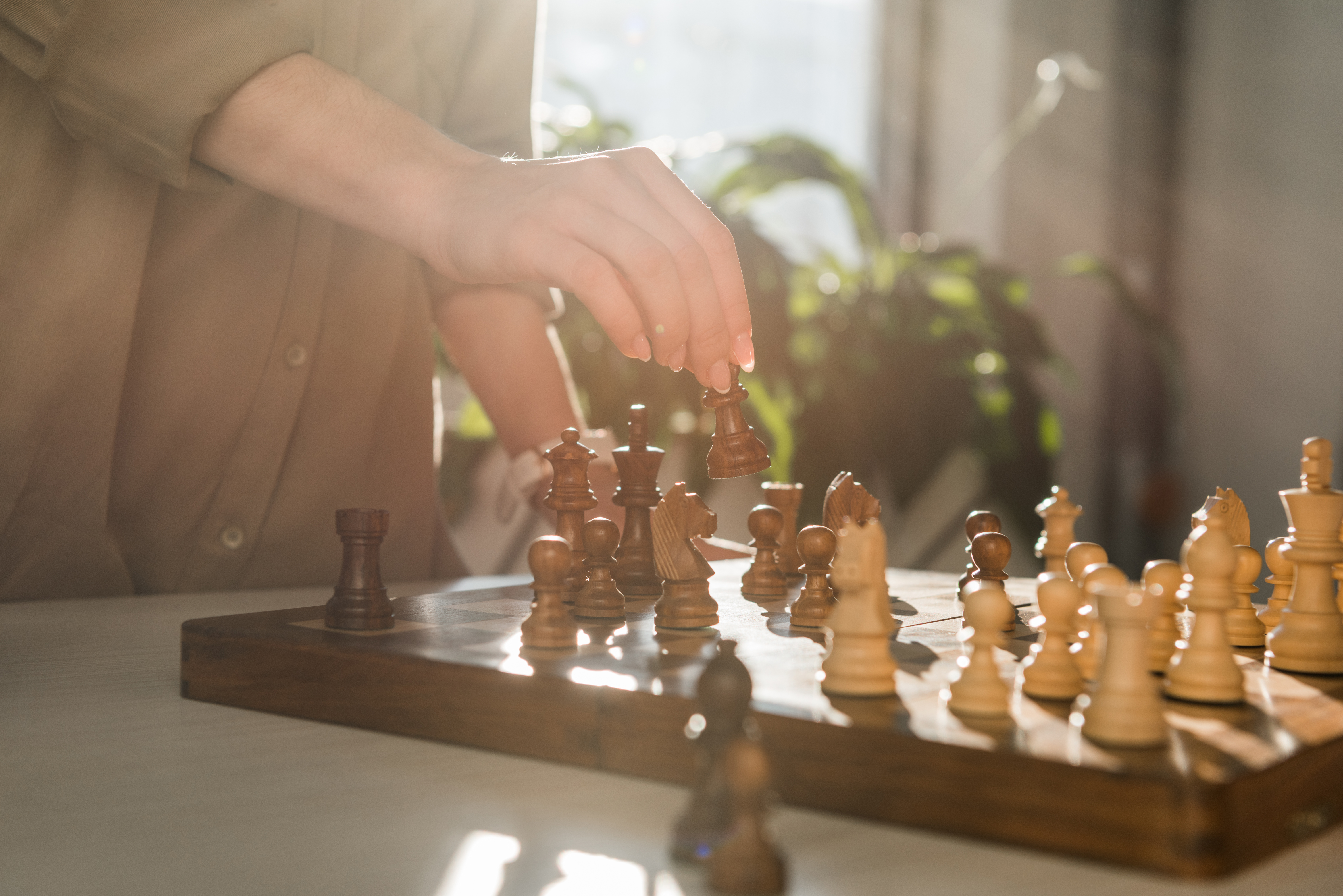 Cropped shot of woman making move while playing chess
