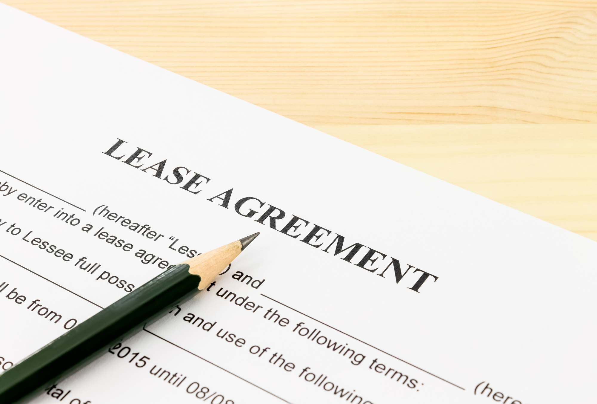 Lease Agreement Contract Document and Pencil Bottom Left Corner
