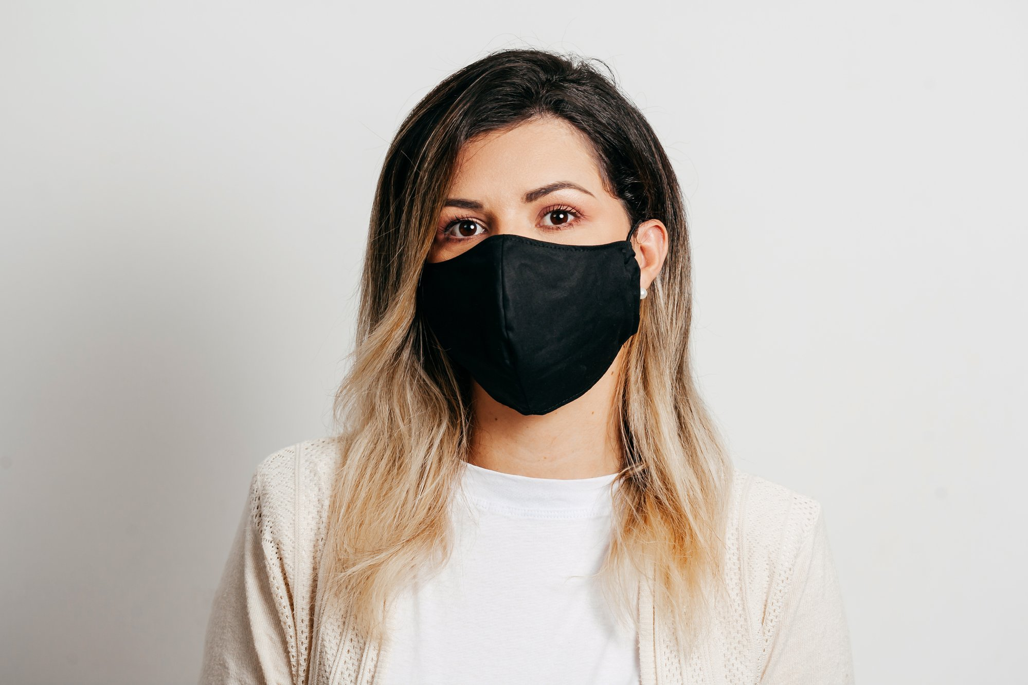Portrait of woman wearing handmade cotton fabric face mask. Protection against COVID-19