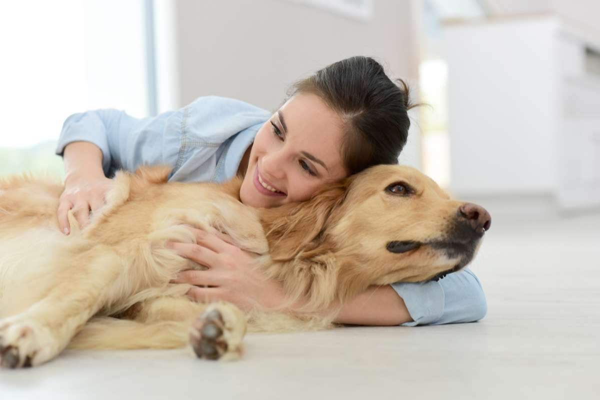 Woman petting her dog (R) (S)